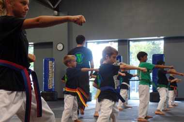 kids punching in karate class