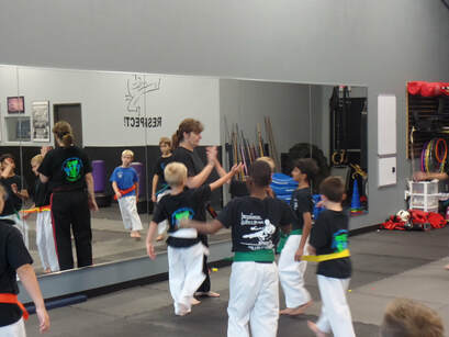 Karate instructor high fives students